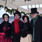 Costumed Victorian Carolers Strolling Main Street
