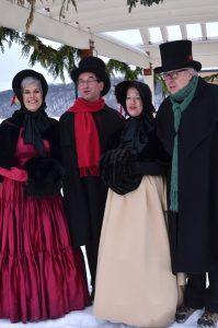 Costumed Victorian Carolers Strolling Main Street